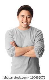 Young good looking man standing wearing a grey shirt. White background.