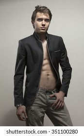 Young good-looking model  in dark suite  with naked torso