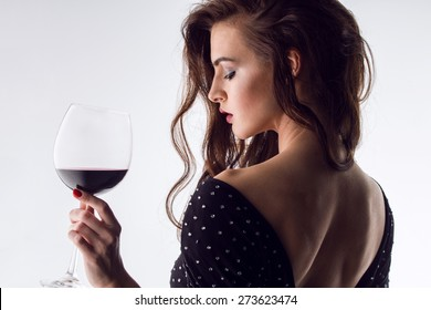 young gorgeous brunette with glass of red wine