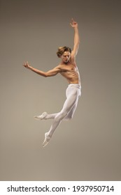 Young and graceful ballet dancer isolated on studio background. Art, motion, action, flexibility, inspiration concept.
