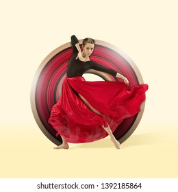 Young graceful female dancer dancing over yellow studio background. Woman dancing in red skirt. The dance, grace, artist, contemporary, movement, action and dynamic concept. Abstract design.