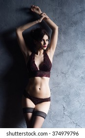 Young and graceful woman posing in a fashion lingerie.