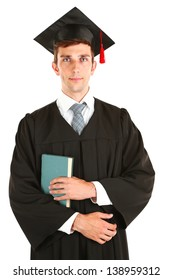 Young graduation man with book, isolated on white