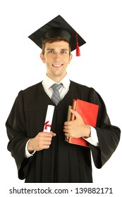 Young graduation man holding diploma and books, isolated on white