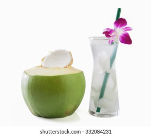 Young green coconut with drinking straw and orchid isolated on white background.