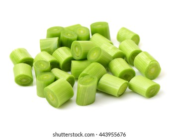 young green garlic leaves isolated on white background