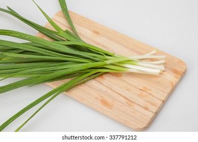 young green garlic on a cutting board. close-up