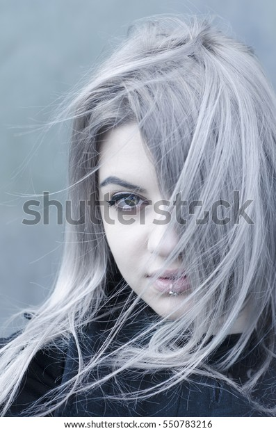 Young grey haired girl portrait in the wind