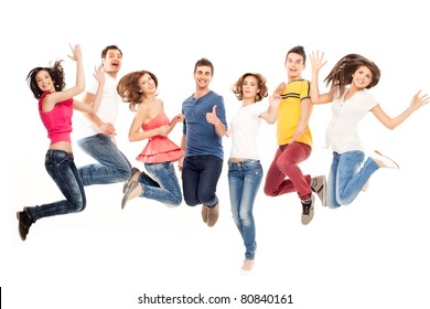 young group of casual, smiling people jumping