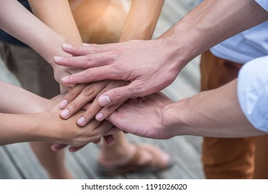 Young group of friend join our team and hands for working together with the job success , Hands, symbolizing the hands to unity and teamwork ,success ,helps , business concept.