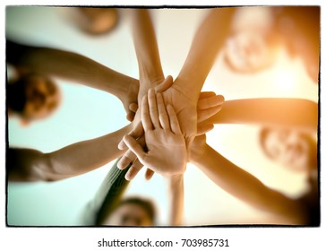 Young group are join hands for working the job success , Hands, symbolizing the hands to unity and teamwork ,success ,helps , business concept.