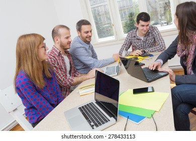 Young group of people discussing business plans.