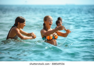 young group of people the playing in sea