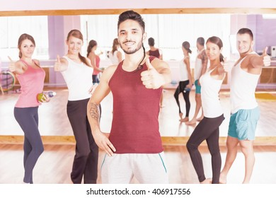 Young group people of women and men lead a healthy lifestyle, exercise with thumbs up gesture. Exercise strengthens a person physically and make them more happy! Succes