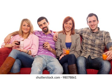 Young Group Sitting on Sofa and Drinking
