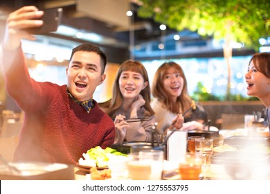 young Group  taking selfie in the restaurant