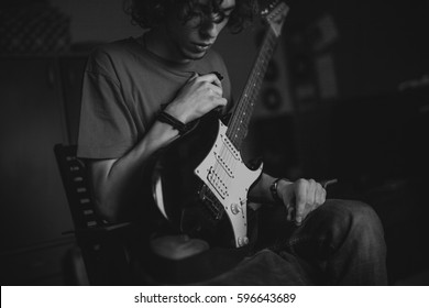 Young guitarist holding an electric guitar