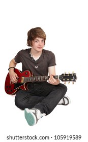 Young guitarist sitting crossed legs, isolated on white