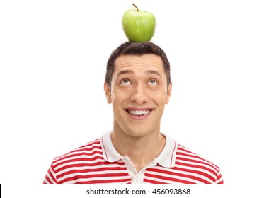 Young guy with an apple on his head isolated on white background