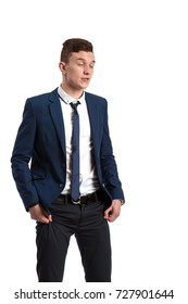 Young guy in blue suit posing against white background