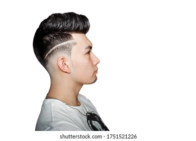 Young guy brunette with pompadour volume haircut 50s - 60s. real photo retro hair style side, for barbershop, isolated.