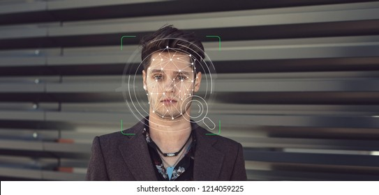 Young guy face ID technology facial recognition use in biometric security for phone or mobile scanning detection. Smart artificial intelligence facial recognition for identity verification used data