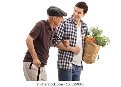 Young guy helping an elderly man with his groceries isolated on white background