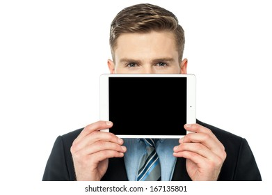 Young guy hiding his face with tablet pc