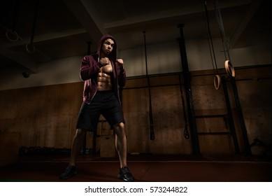 Young guy kickboxer training