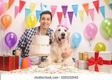 Young guy with a labrador retriever dog celebrating a birthday