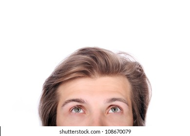 Young guy looking up over white background