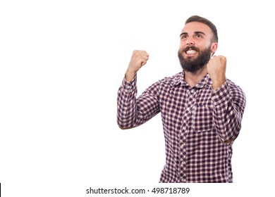 Young guy making a gesture of celebration isolated on white background