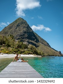 young guy on the beach, tanning men on the white beach of Saint Lucia looking at the blue ocean, St Lucia beach with palm trees