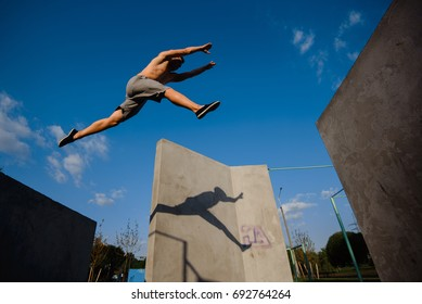 Young guy parkour jumping on the walls