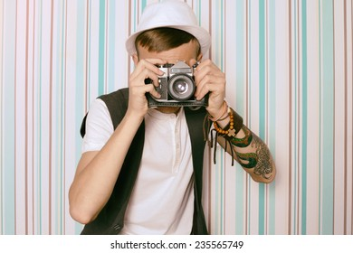 young guy photographer hipster indoor