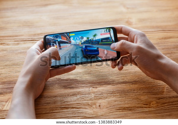 Young Guy Plays Asphalt 9 Mobile Stock Photo (Edit Now) 1383883349