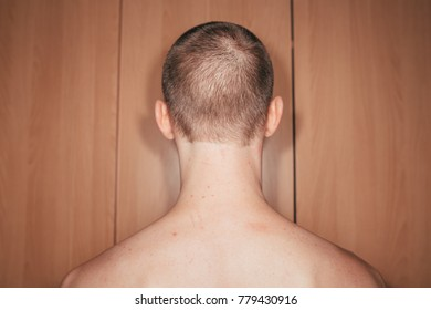 young guy posing in the apartment. parts of the body: wide back, abs and biceps. emotional portrait. touching your body. scars and spots on the skin
