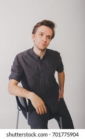 young guy posing in Studio. emotional portrait