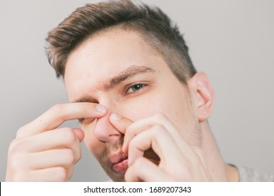 Young guy pushes acne on his face
