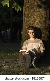 Young guy reads a book.
