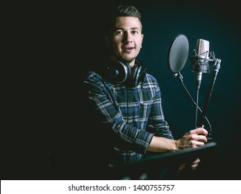 The young guy singing in recording studio