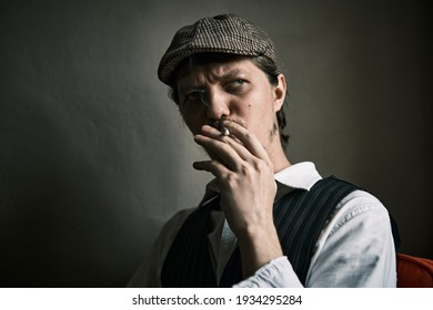 Young guy smoke cigarette, blows smoke, dressed in a retro style, in a beret, cinematic shot, big closeup