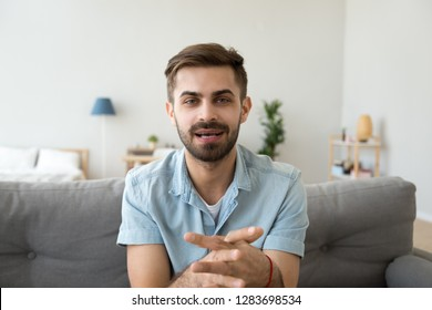 Young guy speaking recording vlog at home looking at camera webcam, male vlogger talking shooting video blog webinar making online call, communicating having distant job interview e-coaching teaching