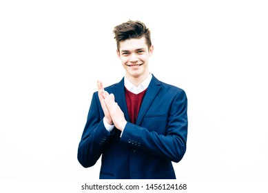 Young guy in a suit excited and celebrating isolated on white background.