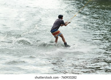 Young guy training surfing