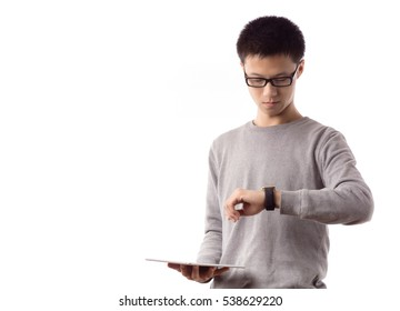 Young guy use smartwatch and tablet pc
