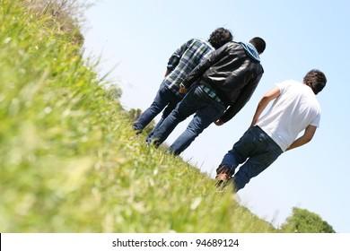 Young Guys walking away