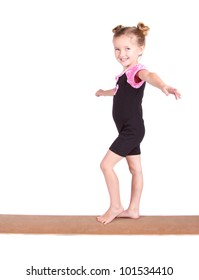Young gymnast balances on beam isolated on white