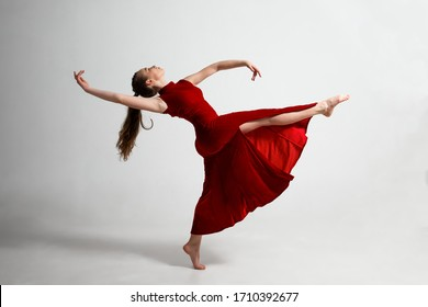 Young gymnast in a beautiful red dress