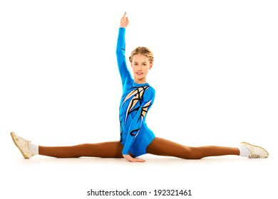 Young gymnast girl doing the splits. Professional sports. Isolated over white.